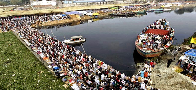 Devotees take part in the first phase of Bishwa Ijtema  on the bank of the River Turag at Tongi on the outskirts the Dhaka, Bangladesh